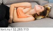 Купить «Sick teenager girl have strong stomach-ache», фото № 32283113, снято 14 ноября 2019 г. (c) Яков Филимонов / Фотобанк Лори