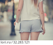 Купить «Female buttocks in blue shorts», фото № 32283121, снято 15 августа 2017 г. (c) Яков Филимонов / Фотобанк Лори