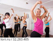 Купить «Ordinary active females exercising dance moves», фото № 32283405, снято 21 сентября 2019 г. (c) Яков Филимонов / Фотобанк Лори