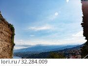 Купить «Aerial view of Taormina from ancient Greek amphitheater walls, Ionian Sea view», фото № 32284009, снято 17 мая 2019 г. (c) Ирина Мойсеева / Фотобанк Лори