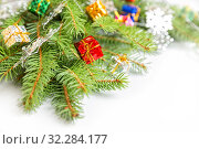 Купить «Decorated Christmas Tree Branch», фото № 32284177, снято 10 октября 2019 г. (c) Юлия Бабкина / Фотобанк Лори