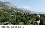 Купить «Foros. Crimea - June 9. 2019.View of the village from a height», видеоролик № 32284517, снято 16 октября 2019 г. (c) Володина Ольга / Фотобанк Лори