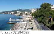 Купить «Yalta, Crimea -June 27. 2019 The Famous city paid Massandra beach», видеоролик № 32284525, снято 17 октября 2019 г. (c) Володина Ольга / Фотобанк Лори