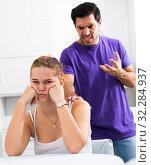 Купить «Stressed woman at table with screaming husband behind», фото № 32284937, снято 5 июня 2020 г. (c) Яков Филимонов / Фотобанк Лори