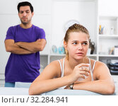 Купить «Upset girl at table after discord with man», фото № 32284941, снято 15 октября 2019 г. (c) Яков Филимонов / Фотобанк Лори