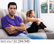 Купить «Man on sofa after quarrel with wife», фото № 32284945, снято 15 октября 2019 г. (c) Яков Филимонов / Фотобанк Лори