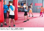 Купить «Teenage boy sportsman at boxing workout», фото № 32285081, снято 12 апреля 2017 г. (c) Яков Филимонов / Фотобанк Лори