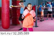Teenage girl boxer in boxing hall. Стоковое фото, фотограф Яков Филимонов / Фотобанк Лори