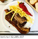 Купить «Grilled veal meat with potatoes. Churrasco de ternera. Spanish cuisine», фото № 32285337, снято 22 октября 2019 г. (c) Яков Филимонов / Фотобанк Лори