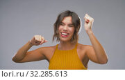 Купить «happy laughing young woman in headphones dancing», видеоролик № 32285613, снято 7 октября 2019 г. (c) Syda Productions / Фотобанк Лори