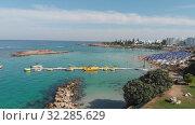 Protaras, Cyprus - Oct 11. 2019 The Famous fig tree beach of city. Редакционное видео, видеограф Володина Ольга / Фотобанк Лори