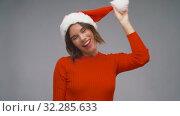 Купить «woman in santa helper hat having fun on christmas», видеоролик № 32285633, снято 7 октября 2019 г. (c) Syda Productions / Фотобанк Лори
