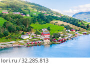 Купить «Small  houses at Olden, Norway.Olden is a village and urban area in the municipality of Stryn in Sogn og Fjordane county, Norway.», фото № 32285813, снято 10 июля 2020 г. (c) Николай Коржов / Фотобанк Лори
