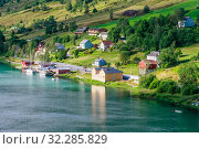 Купить «Small  houses at Olden, Norway.Olden is a village and urban area in the municipality of Stryn in Sogn og Fjordane county, Norway.», фото № 32285829, снято 7 августа 2020 г. (c) Николай Коржов / Фотобанк Лори