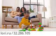 Купить «african baby girl playing with toy blocks at home», видеоролик № 32286105, снято 8 октября 2019 г. (c) Syda Productions / Фотобанк Лори
