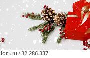 Купить «christmas gifts and fir branches with pine cones», видеоролик № 32286337, снято 29 января 2020 г. (c) Syda Productions / Фотобанк Лори