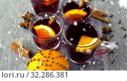 Купить «hot mulled wine in glasses with orange and spices», видеоролик № 32286381, снято 10 июля 2020 г. (c) Syda Productions / Фотобанк Лори