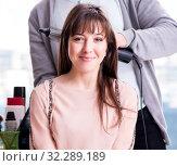 Купить «The man stylist working with woman in beauty salon», фото № 32289189, снято 18 декабря 2017 г. (c) Elnur / Фотобанк Лори