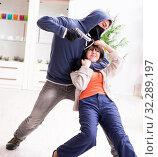 Купить «Armed man assaulting young woman at home», фото № 32289197, снято 15 декабря 2017 г. (c) Elnur / Фотобанк Лори
