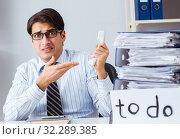 Купить «Businessman failing to deliver his to-do list», фото № 32289385, снято 24 ноября 2017 г. (c) Elnur / Фотобанк Лори