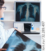 Купить «Doctor radiologist looking at x-ray images», фото № 32289497, снято 3 ноября 2017 г. (c) Elnur / Фотобанк Лори