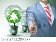 Купить «Green energy anc ecology concept with businessman», фото № 32290677, снято 11 июля 2020 г. (c) Elnur / Фотобанк Лори