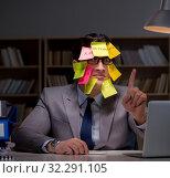 Купить «Businessman staying late to sort out priorities», фото № 32291105, снято 25 января 2017 г. (c) Elnur / Фотобанк Лори