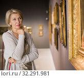 Купить «Female visitor looking at artwork painting», фото № 32291981, снято 7 октября 2017 г. (c) Яков Филимонов / Фотобанк Лори