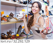 Купить «Glad woman choosing pair of summer shoes», фото № 32292129, снято 28 января 2020 г. (c) Яков Филимонов / Фотобанк Лори