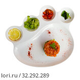 Купить «Tasty tartar from salmon served with vegetables and lemon», фото № 32292289, снято 19 июля 2019 г. (c) Яков Филимонов / Фотобанк Лори