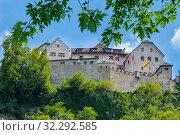 Vaduz Liechtenstein - August 05 2019: Schloss Vaduz castle looms over the capital of Liechtenstein from the hill above. Редакционное фото, фотограф Григорий Стоякин / Фотобанк Лори
