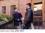 Купить «Young man and woman talking and laugh while standing on the balcony of the old building», фото № 32295901, снято 20 сентября 2019 г. (c) Евгений Харитонов / Фотобанк Лори