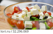 Купить «woman cooking vegetable salad with feta and spices», видеоролик № 32296069, снято 10 октября 2019 г. (c) Syda Productions / Фотобанк Лори