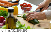 Купить «woman chopping cucumber with kitchen knife at home», видеоролик № 32296293, снято 10 октября 2019 г. (c) Syda Productions / Фотобанк Лори