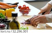 Купить «young woman chopping red onion at home», видеоролик № 32296301, снято 10 октября 2019 г. (c) Syda Productions / Фотобанк Лори