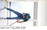 Купить «man in headphones cleaning floor by mop at home», видеоролик № 32296329, снято 9 октября 2019 г. (c) Syda Productions / Фотобанк Лори