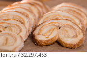 Купить «fried Palmier laid out on counter», фото № 32297453, снято 30 января 2018 г. (c) Татьяна Яцевич / Фотобанк Лори