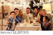 Купить «family having birthday party and taking selfie», фото № 32297513, снято 15 декабря 2018 г. (c) Syda Productions / Фотобанк Лори