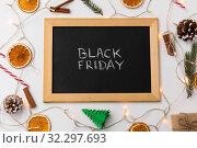 Купить «chalk board with black friday words on christmas», фото № 32297693, снято 19 декабря 2018 г. (c) Syda Productions / Фотобанк Лори