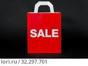 Купить «red shopping bag with sale word», фото № 32297701, снято 20 декабря 2018 г. (c) Syda Productions / Фотобанк Лори