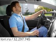 Купить «man or driver driving car», фото № 32297745, снято 25 августа 2019 г. (c) Syda Productions / Фотобанк Лори