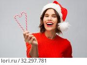 Купить «happy young woman in santa hat on christmas», фото № 32297781, снято 30 сентября 2019 г. (c) Syda Productions / Фотобанк Лори