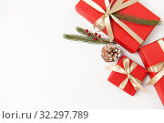 Купить «christmas gifts and fir branches with pine cones», фото № 32297789, снято 26 сентября 2018 г. (c) Syda Productions / Фотобанк Лори