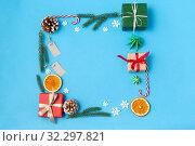 Купить «frame of gifts, fir branches, tags and decorations», фото № 32297821, снято 26 сентября 2018 г. (c) Syda Productions / Фотобанк Лори