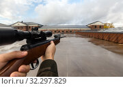 POV of male hands shooting with air rifle. Стоковое фото, фотограф Syda Productions / Фотобанк Лори