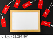 Купить «white board and red tags with discount signs», фото № 32297861, снято 19 декабря 2018 г. (c) Syda Productions / Фотобанк Лори