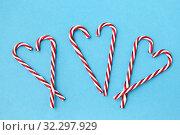 Купить «candy cane decorations in shape of hearts», фото № 32297929, снято 26 сентября 2018 г. (c) Syda Productions / Фотобанк Лори