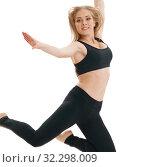Купить «Slim sportswoman gracefully jumping in studio», фото № 32298009, снято 25 сентября 2016 г. (c) Гурьянов Андрей / Фотобанк Лори