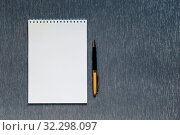 Купить «Flatlay with mockup. Office supplies, notebook with blank page for writing text, pen, on gray background with copy space», фото № 32298097, снято 13 октября 2019 г. (c) Светлана Евграфова / Фотобанк Лори