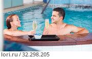 Купить «Romantic couple is relaxing with glasses of vine», фото № 32298205, снято 18 июля 2017 г. (c) Яков Филимонов / Фотобанк Лори